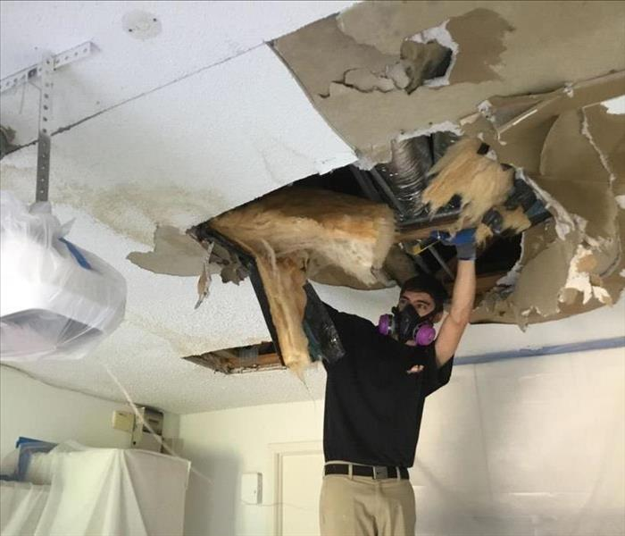 Water damage to the ceiling of a garage