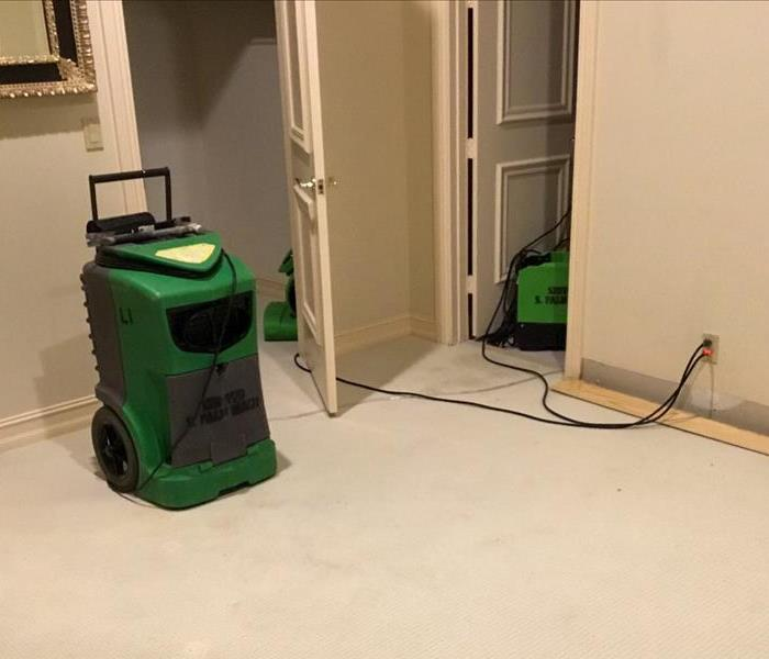 Extracting water from a carpet in a bedroom